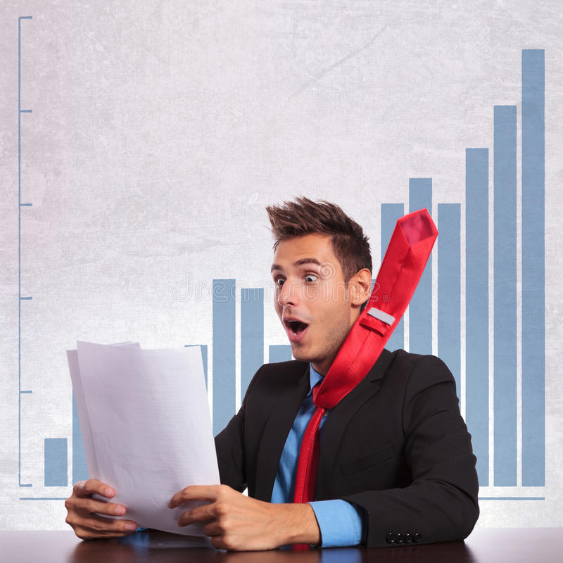 Business man with flying tie reading the good news royalty free stock images