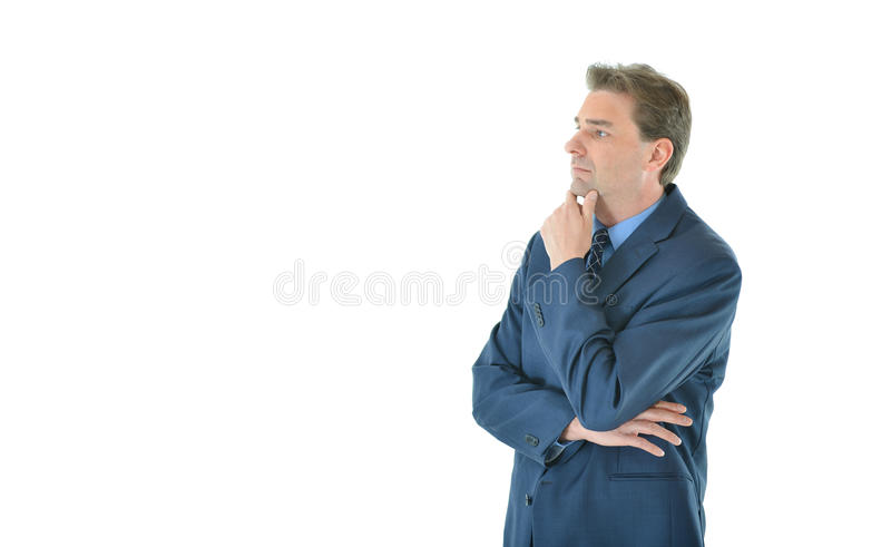 Download Business Man With Folded Arms Looking Away Stock Photo - Image: 83718672