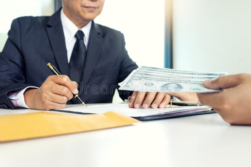 Business man give bribe to the officer concept corruption stock image