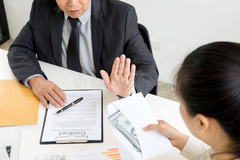 Business man give bribe to the officer but officer say no stock photography