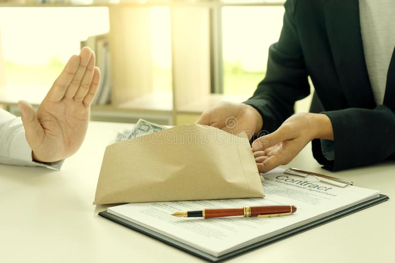 Business man give bribe to the officer but say no royalty free stock images