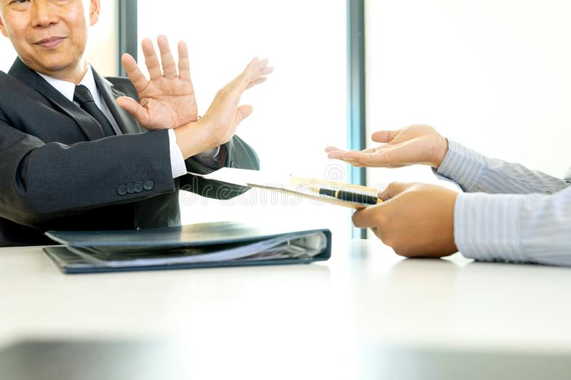 Business man give bribe to the officer but officer say no royalty free stock photography