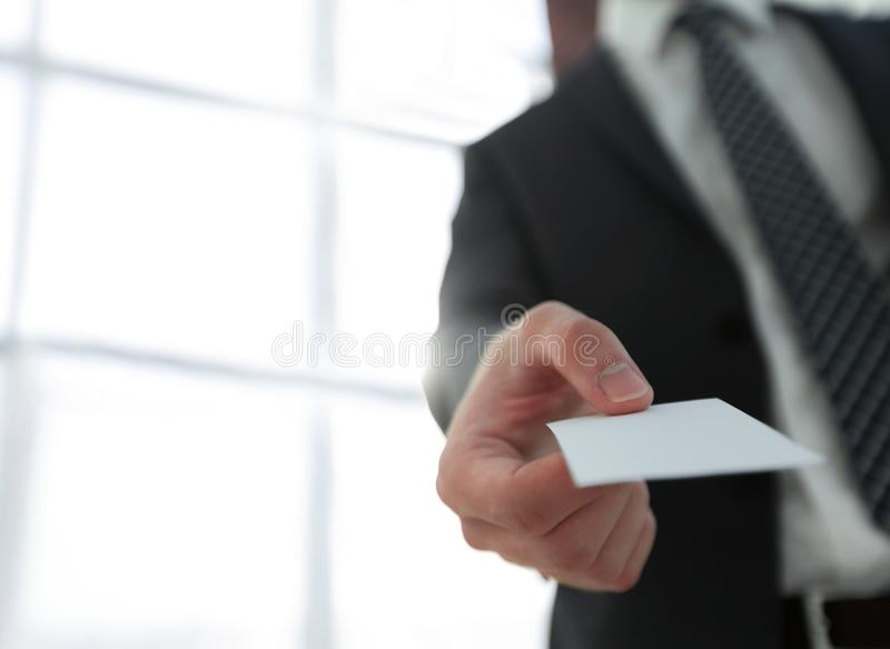 Business man giving business card on bright background stock photo two successful business executive exchanging business card colourmoves