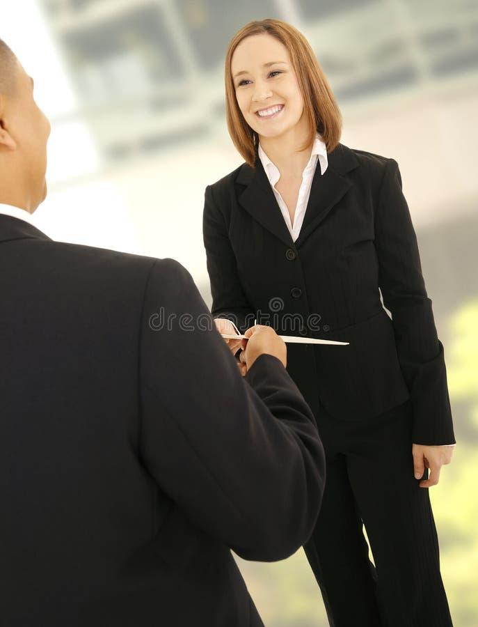 Business Man Giving Folder To Teammate stock photos