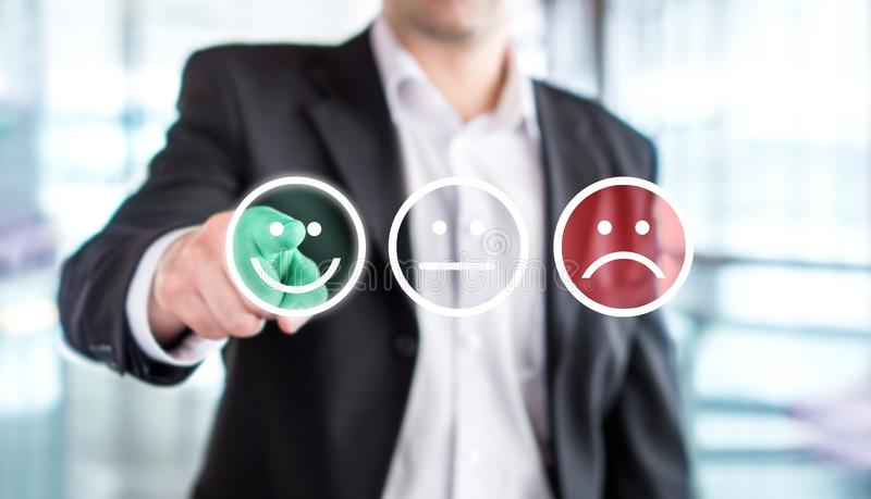 Business man giving rating and review with happy smiley face. Business man giving rating and review with happy smiley face emoticon icon. Customer satisfaction stock image