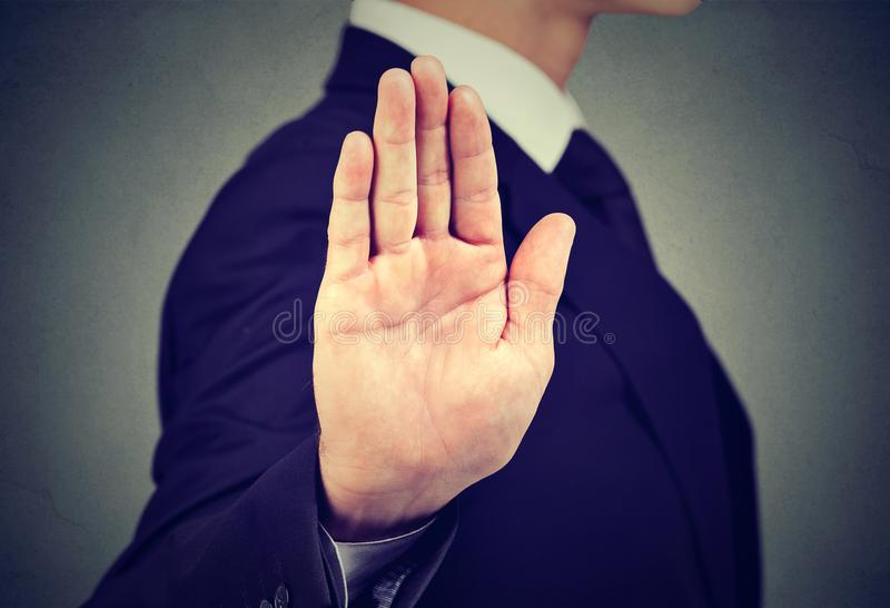 Business man giving stop hand gesture royalty free stock image