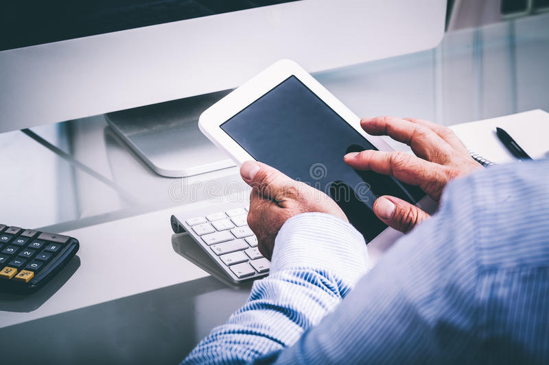 Download Business Man On Glass Desk With Phone Stock Photo - Image: 83708929