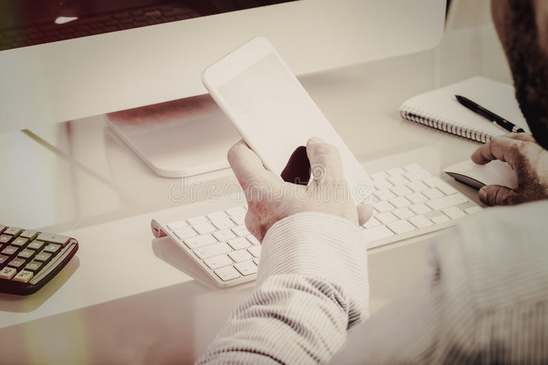 Download Business Man On Glass Desk With Phone Stock Photo - Image: 83709192