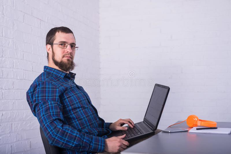 Business man with glasses working on a laptop royalty free stock photography