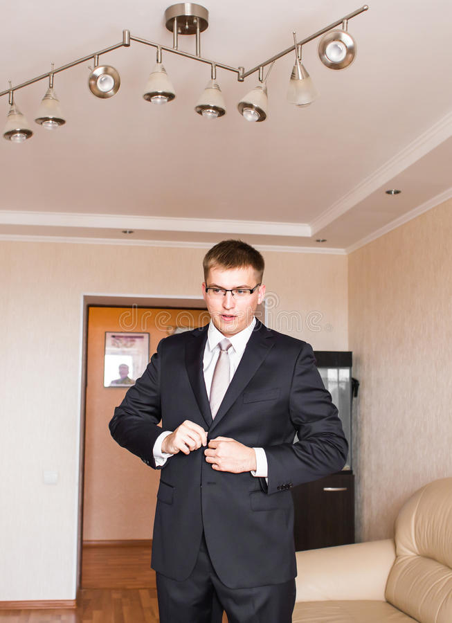 Business man or Groom wearing suit on wedding day and preparing. Business man or Groom wearing suit on wedding day and preparing royalty free stock images