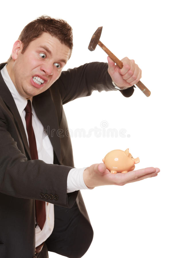 Business man with hammer about to smash piggy bank. Money saving concept. Nerdy funny business man guy with hammer about to smash piggy bank isolated on white stock photos