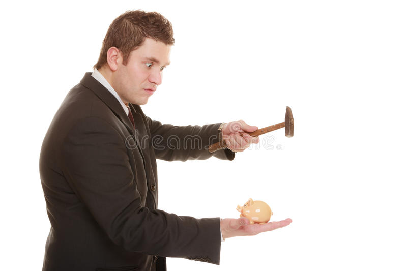 Business man with hammer about to smash piggy bank. Money saving concept. Nerdy funny business man guy with hammer about to smash piggy bank isolated on white royalty free stock photo