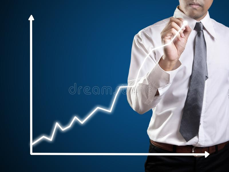 Business man hand drawing a graph. Shares, market, leadership, , forecasting, copy, white, achievement, sketching, future, consultant, blank, whiteboard, line royalty free stock photos