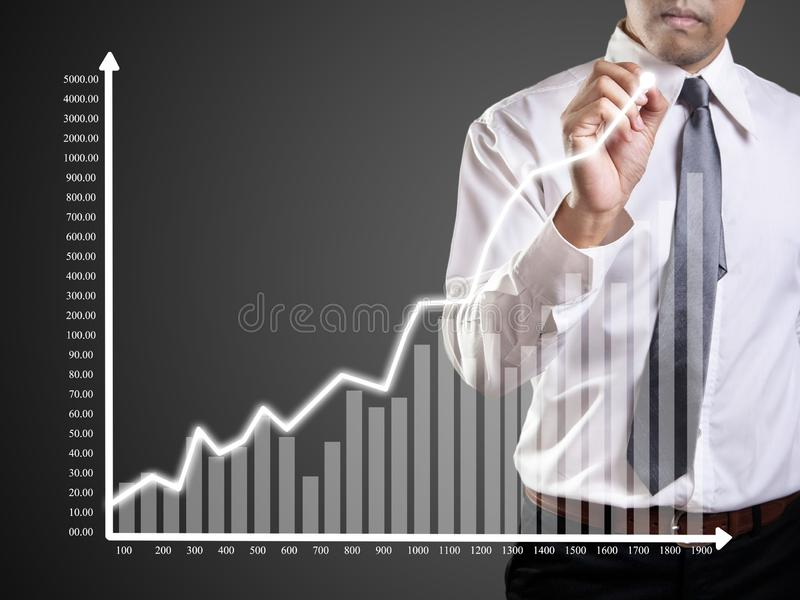 Business man hand drawing a graph. Shares, market, leadership, , forecasting, copy, white, achievement, sketching, future, consultant, blank, whiteboard, line stock images