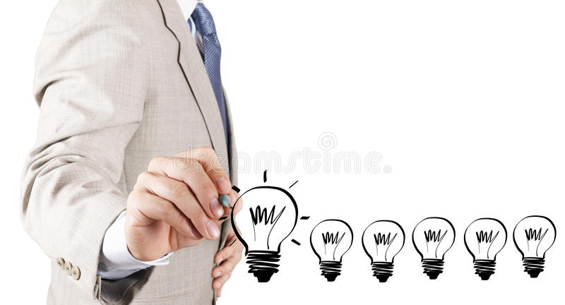 Business man hand drawing idea light bulb. As concept royalty free stock photo