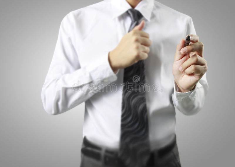 Business man hand drawing in whiteboard. Business man hand drawing in the whiteboard royalty free stock image