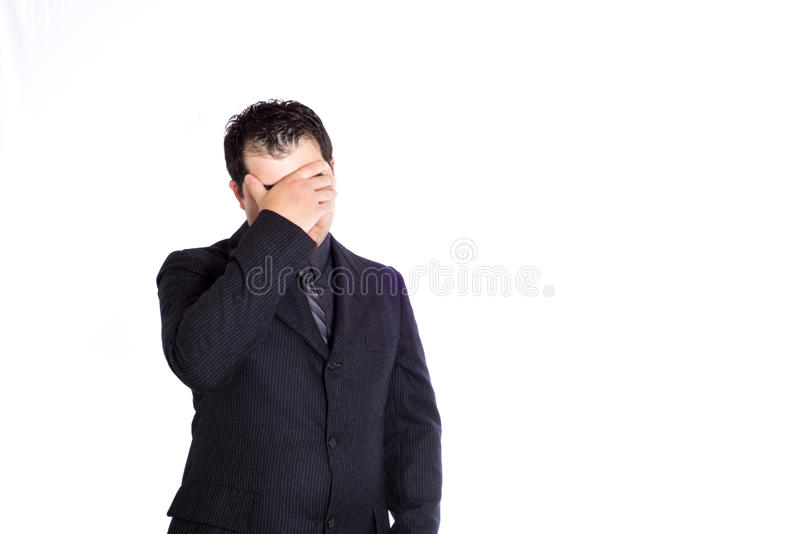 Business man hand on forehead. A businessman with his hand on his forehead. White background royalty free stock images