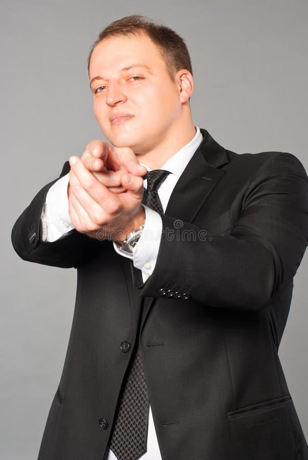 Business Man - Hand Gun Stick Up Stock Photo