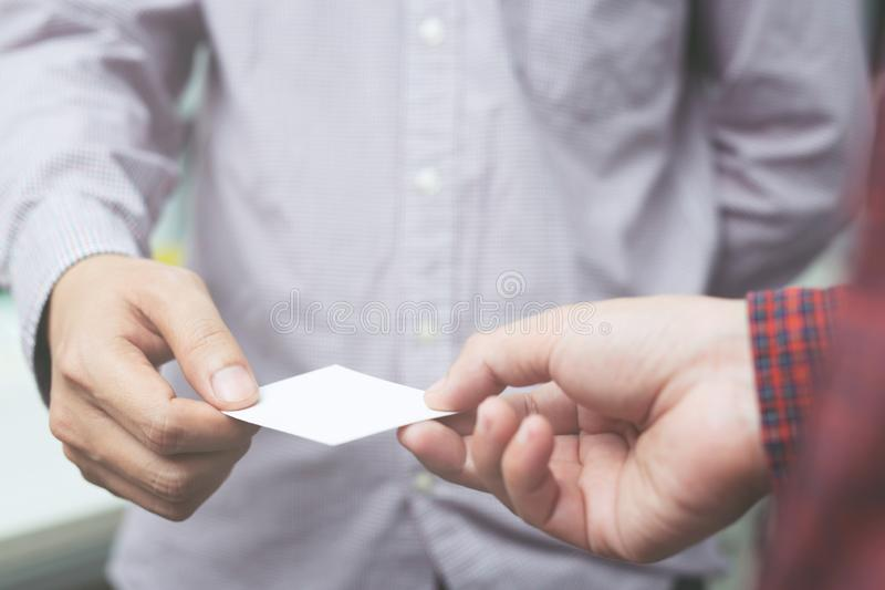 Business man in hand hold show business cards blank empty white card mock up filing give to connect Partner stock photo
