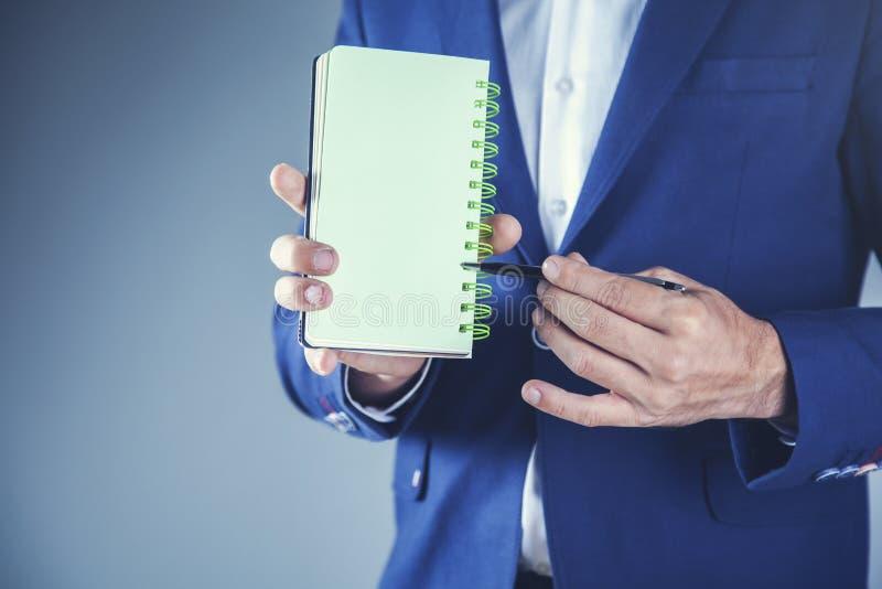 Man hand  notepad royalty free stock image