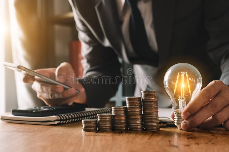 Idea saving energy and accounting finance concept royalty free stock image