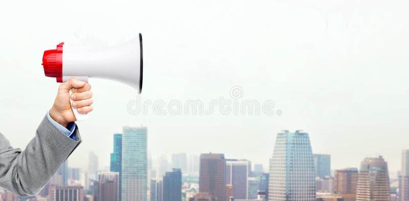 Business man hand holding megaphone royalty free stock photo