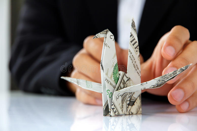 Business man hand holding origami paper cranes royalty free stock photos