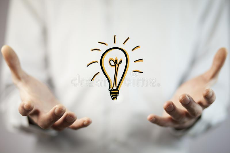 Business man hand idea. With light idea stock image