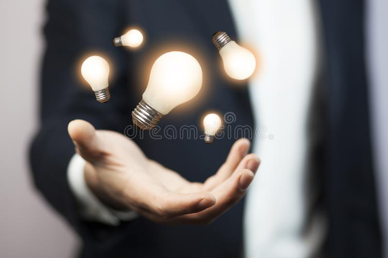 Business man hand idea. With light bulb royalty free stock photos