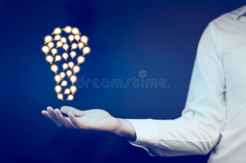 Business man hand idea. With light bulb stock images