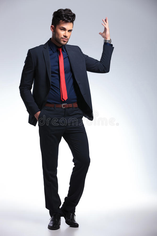 Business man with a hand in pocket stock photos