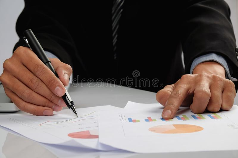 Business man hand pointing at business document during discussion at meeting stock image