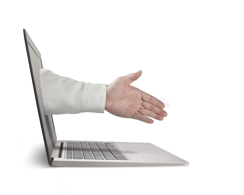 Business man hand reaching out from screen to shake with royalty free stock image