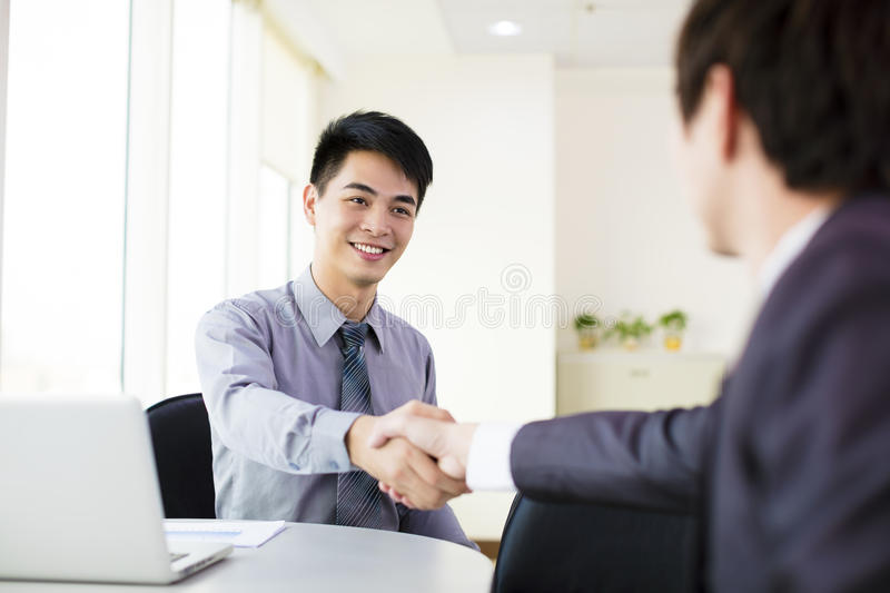 Business man hand shaking. Business men hand shaking in office royalty free stock photo