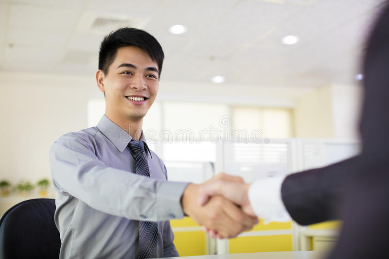 Business man hand shaking. In office stock photo