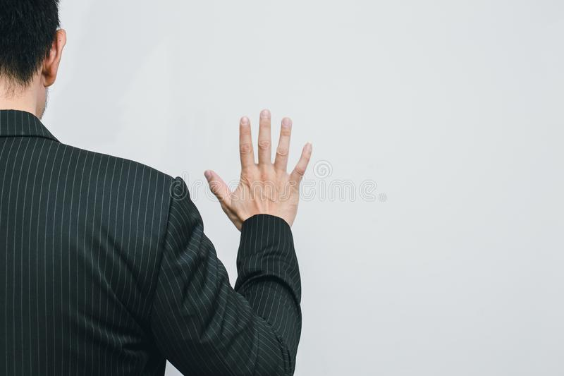 Business man hand show number 5 view from back stock image