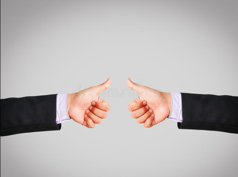Business man hand in suit showing thumb up stock image