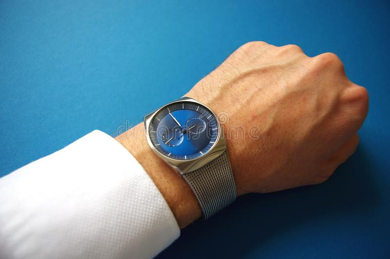 Business man with hand watches, success and business concept, time management royalty free stock photos
