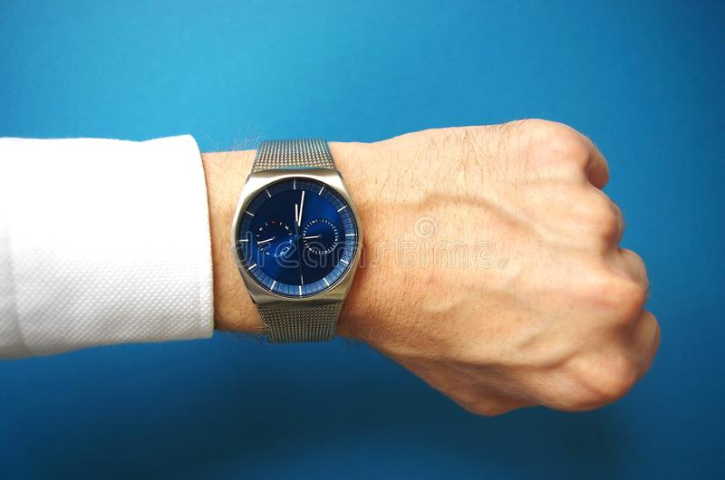 Business man with hand watches, success and business concept, time management royalty free stock image