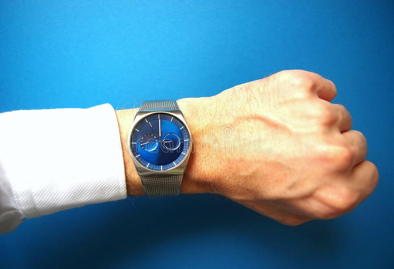 Business man with hand watches, success and business concept, time management stock photography