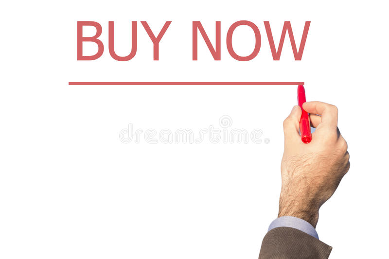 Business man hand writing buy now on a transparent wipe board. Isolated on white background.red marker.pen royalty free stock photos