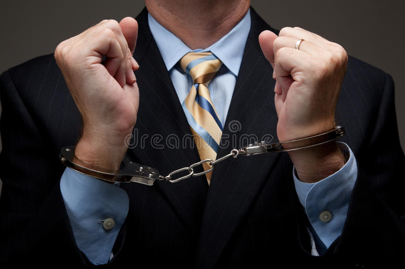 Business man in handcuffs royalty free stock image