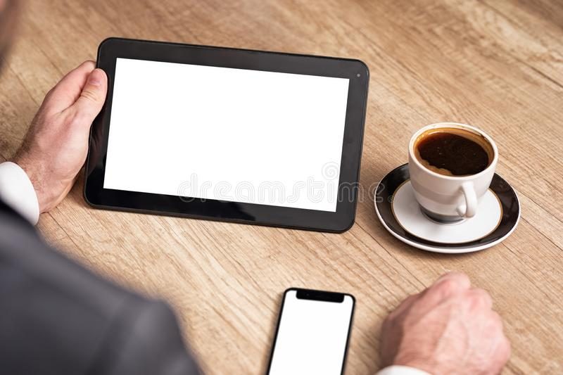 Business man hands holding digital tablet with empty blank screen for your text message stock photo