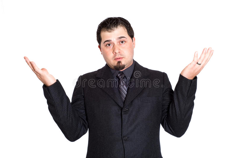 Business man hands out skeptical. A skeptical looking businessman with hands out. White background royalty free stock images