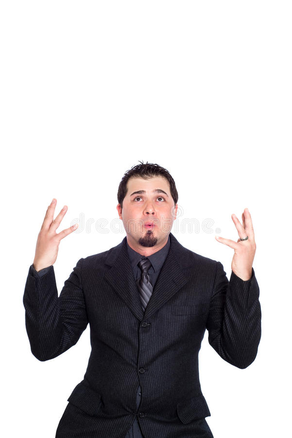 Business man hands out upset. An upset/distraught looking businessman with hands out. White background royalty free stock photo