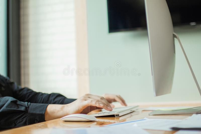 Business man hands using computer with blank screen on desk royalty free stock images