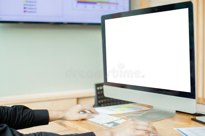 Business man hands using computer with blank screen on desk in cafe. royalty free stock images