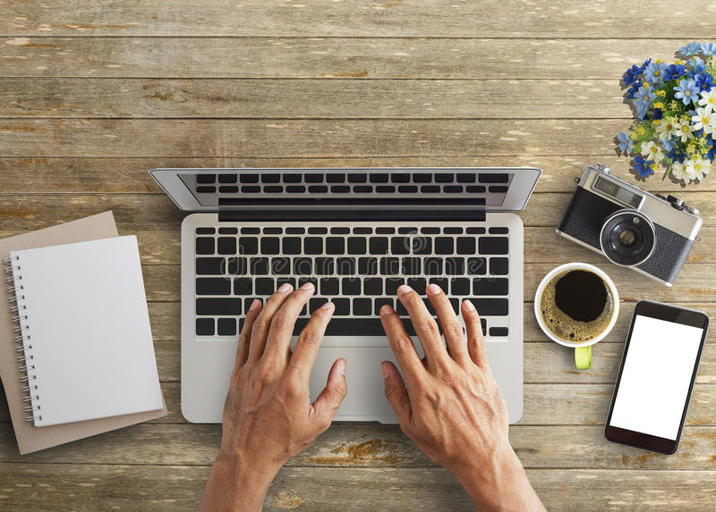 Business man hands using a laptop royalty free stock photo