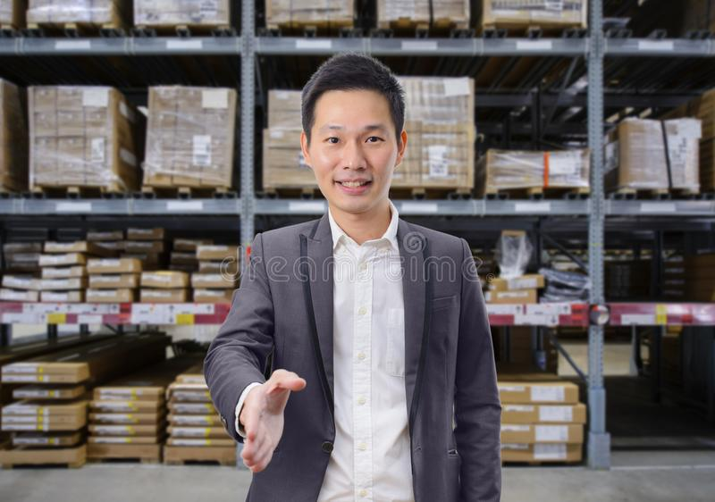 Business man handshake deal business with warehouse image blur background stock image