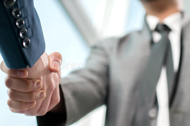 Business Man. Business handshake and business people stock photography